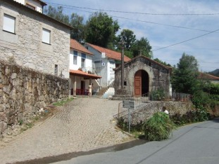 10 Revolta with chapel to Our Lady of the Snows and a good cafe, plus a man with a well-loaded whellbarrow on the road